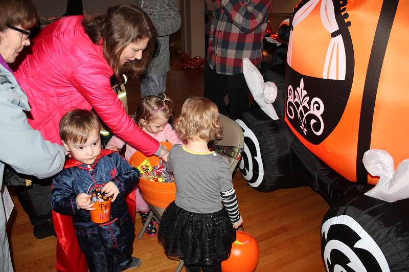 REVIEW PHOTO: CLAIRE HOLLEY - A group of Lake Oswego little ones collect candy from one of the many bowls at the Monster Mash.
