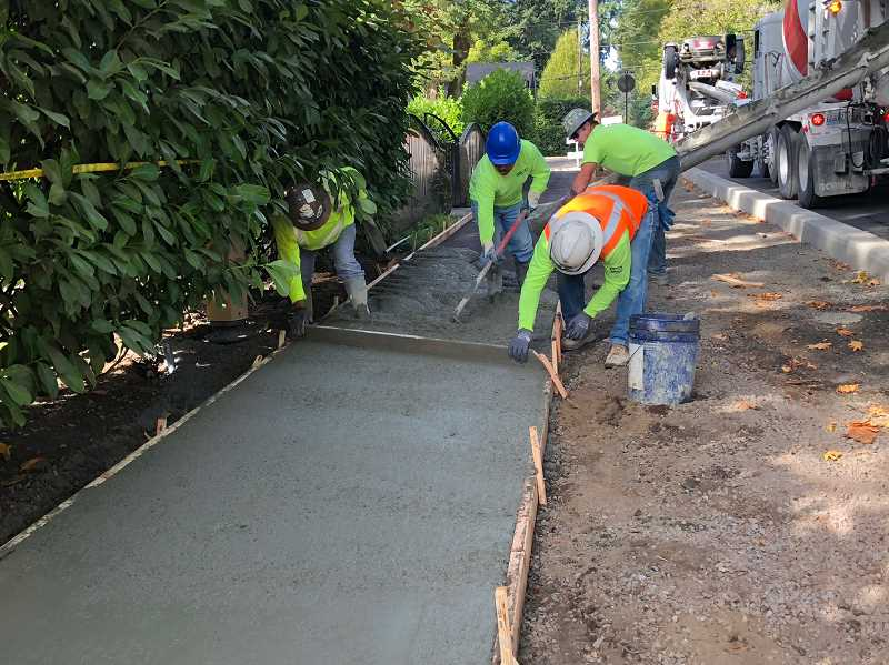 PHOTO COURTESY OF CITY OF LAKE OSWEGO  - The final pouring of concrete for sidewalks is expected to wrap up in the next week as crews put the finishing touches on D Avenue.