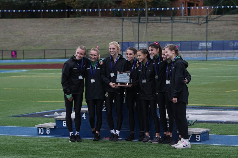 TIMES FILE PHOTO - The Jesuit girls cross country team took second place at the Class 6A state championship meet last week.