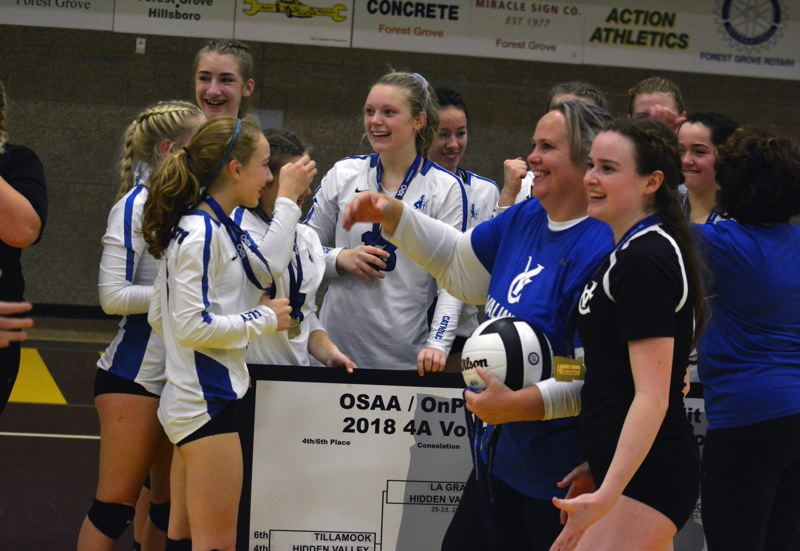TIMES PHOTO: MATT SINGLEDECKER - The Valley Catholic volleyball team, led by head coach Becky Kemper, captured the Class 4A state title last week.