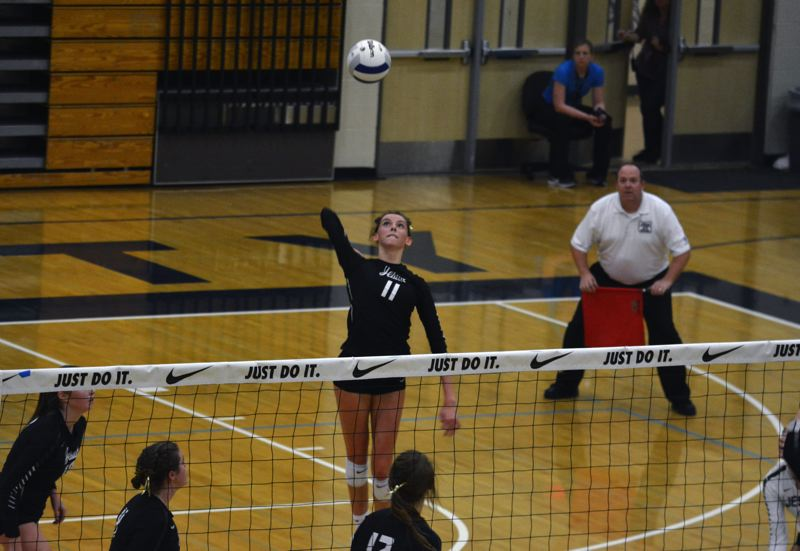TIMES PHOTO: MATT SINGLEDECKER - Jesuit senior Rose Booth had a game-high 16 kills and just three errors against Sprague.