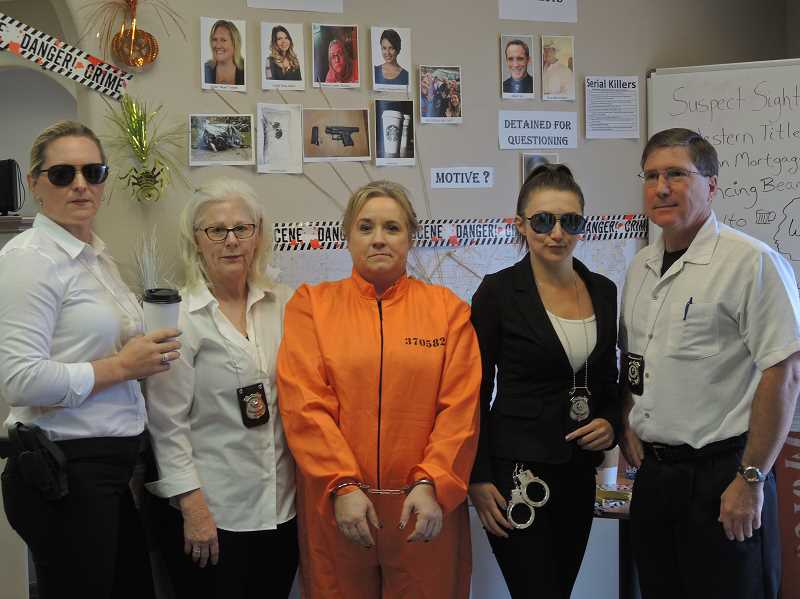 SUBMITTED PHOTO - The staff at D&D Realty's CSI costumes won the Best Costumes Award.