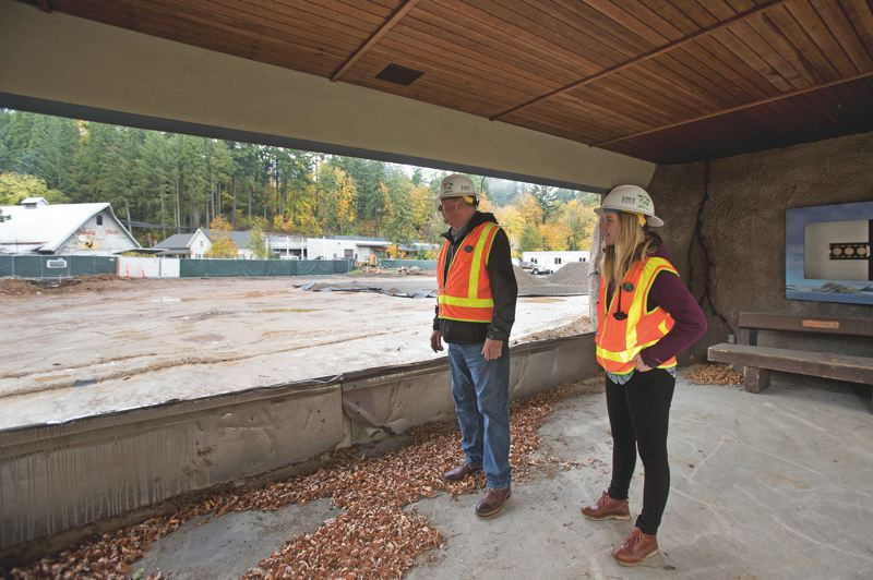 PAMPLIN MEDIA GROUP: JAIME VALDEZ - Jim Mitchell and Kate Giraud, both bond construction managers for construction projects at the Oregon Zoo, look through the window from inside the polar bear viewing structure to see the progress of Polar Passage which is slated to open in the fall of 2020.