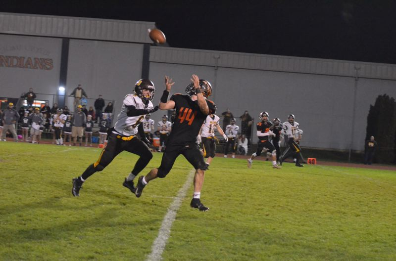 PHOTO COURTESY: JOHN BREWINGTON - Connor McNabb of Scappoose High gets behind a defender and pulls in a long pass during last week's Class 5A playoff victory over North Bend. The Indians visit Pendleton on Friday night for a state quarterfinal game.