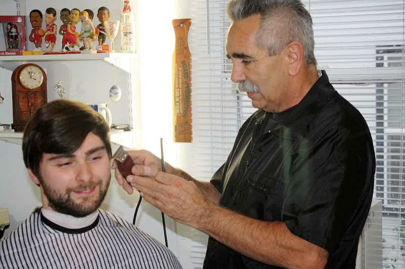 FILE PHOTO - Paul Padilla offers free haircuts by donation to raise funds for Sandy VFW.