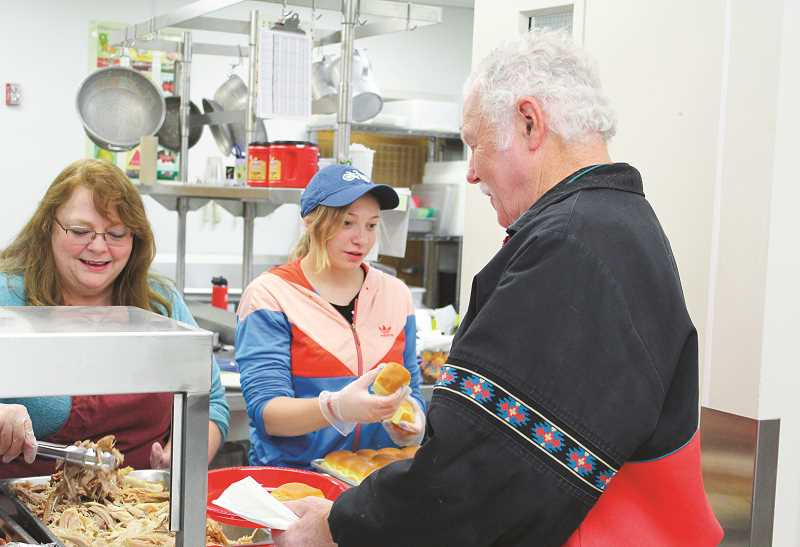 CENTRAL OREGONIAN FILE PHOTO  - Kids Club leaders, volunteers and members all join together to provide community members a free Thanksgiving meal each year.