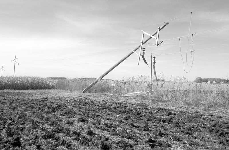 PHOTO COURTESY OF BOWMAN MUSEUM  - Power lines are left damaged after farm equipment collided with them and resulted in the electrocution of two farmers.
