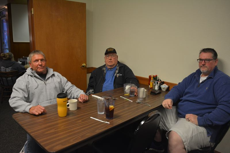 SPOTLIGHT PHOTO: COURTNEY VAUGHN - St. Helens VFW members reflect on their military deployments across the globe. Pictured left to right: Gene Hester, Dave Beldon and Jeffrey Collins.