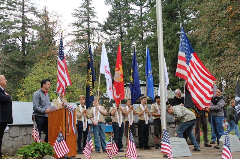 SPOTLIGHT FILE PHOTO - Boy Scout members present the colors during a Veterans Day community ceremony in 2016. This Veterans Day weekend, several community events will take place to honor those who served.