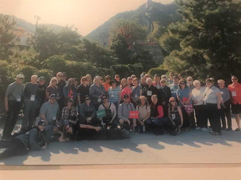 COURTESY OF LANA PAINTER - Chamber and community members stand in front of the Great Wall of China during a trip to that country from Oct. 15-24