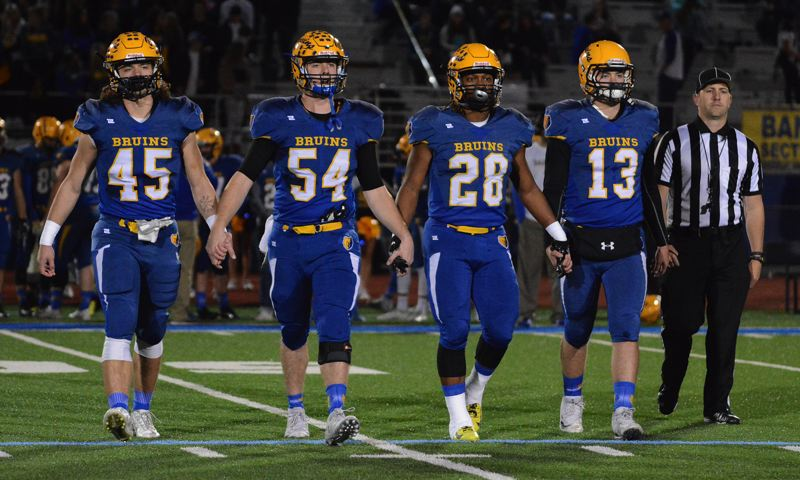 OUTLOOK PHOTO: DAVID BALL - Barlow captains, from left, Jared Eggleston, Nathaniel Koenig, Jobi Malary and Jaren Hunter walk to midfield for the coin flip before last weeks first-round win over Beaverton.