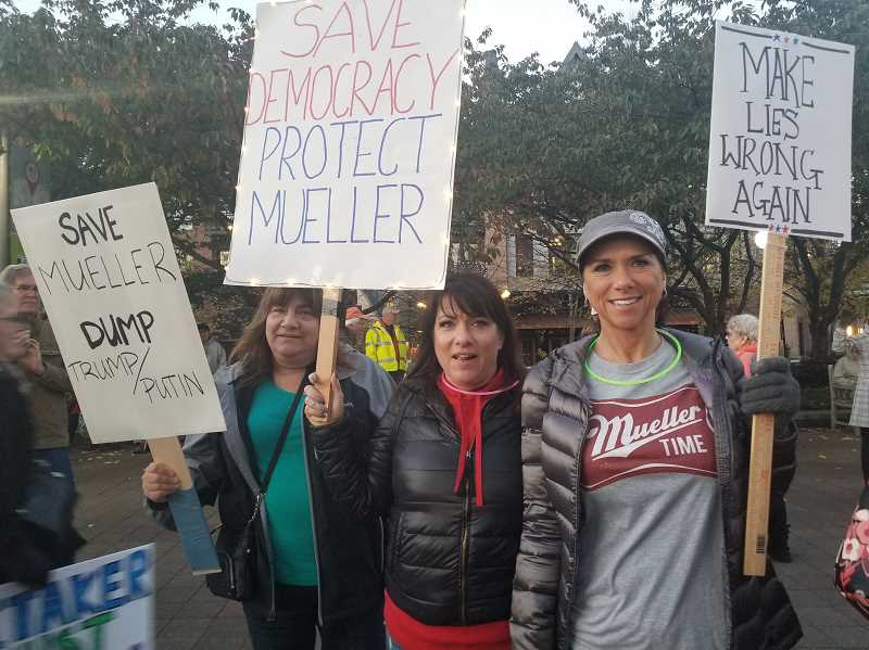 REVIEW PHOTO: GARY M. STEIN - Cindy Melbo (from left), Jami Meyer and Julie Johnson were among the sign-carrying protesters Thursday at a rally to protect Robert Mueller's investigation into posisble Russian collusion in the 2016 election.