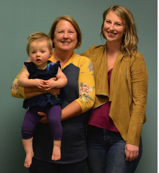 OUTLOOK PHOTO: DAVID BALL - Long-time Reynolds coach Debbie Swoboda and her daughter Katie are among the group being inducted into the Reynolds High Sports Hall of Fame on Friday, Nov. 16. Also pictured here is Debbie's granddaughter Calli — the 1-year-old daughter of her son Kyle.