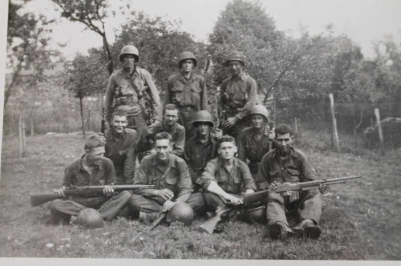 CONTRIBUTED PHOTO - Ray Whipps, back row center, and his men take a breather just north of Paris after the Allied forces liberated the city in August 1944.
