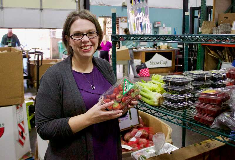 OUTLOOK PHOTO: CHRISTOPHER KEIZUR - SnowCap Community Charities Executive Director Kirsten Wageman is excited about the positive steps made in the past year at the food pantry.