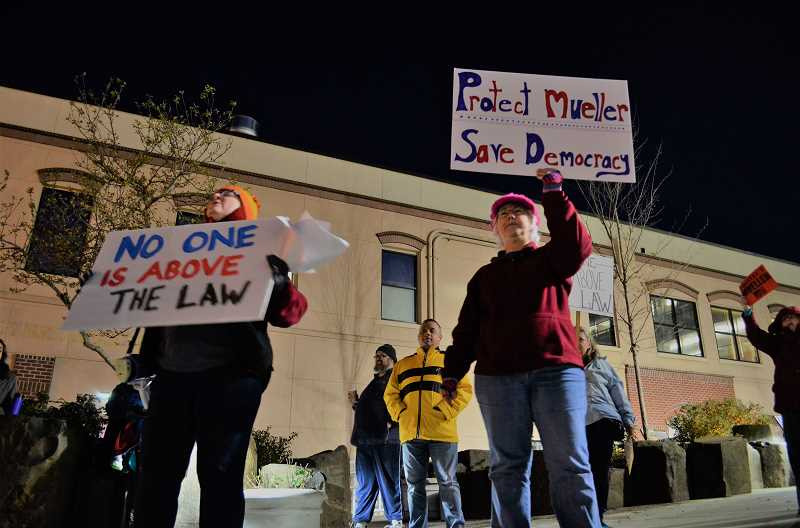 STAFF PHOTO: GEOFF PURSINGER - Protestors chant and carry signs outside the Hillsboro Civic Center on Thursday, Nov. 9.