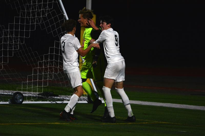 TIMES PHOTO: MATT SINGLEDECKER - Jesuit senior goalie Nolan Aylward made a gigantic save of a Forest Grove penalty kick in the Class 6A semis to help send the Crusaders to the 6A state title game.