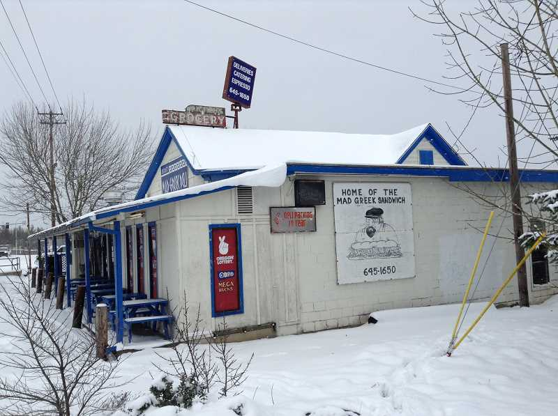 TIMES PHOTO: RAY PITZ - The Mad Greek Deli was covered in snow during a February 2014 storm.
