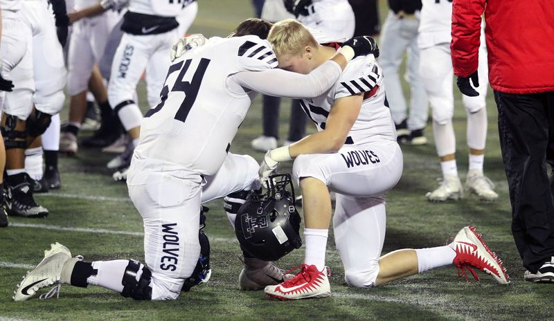 TIMES PHOTO: DAN BROOD - Tualatin senor Alex Armstrong (left) and junior Josh Boespflug quitely get ready for Friday's state playoff game with Central Catholic.
