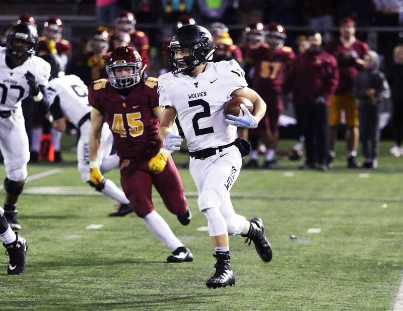 TIMES PHOTO: DAN BROOD - Tualatin senior Caden Dickson had an interception during the Wolves state playoff game with Central Catholic.