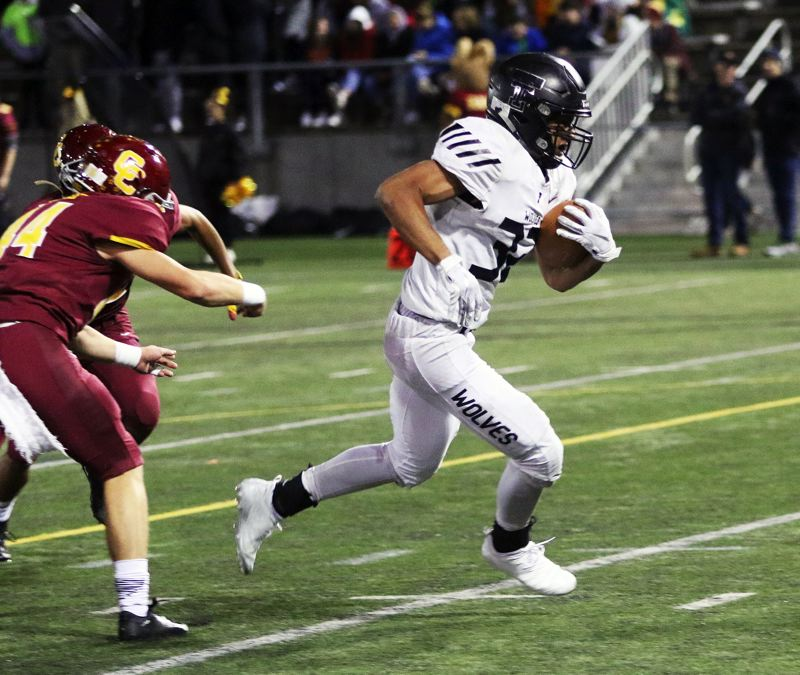 TIMES PHOTO: DAN BROOD - Tualatin senior Dominque Loggins (right) breaks into the clear on his way to scoring on an 8-yard run during the third quarter of Friday's game.
