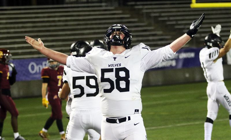 TIMES PHOTO: DAN BROOD - Tualatin senior lineman Dane Norris celebrates following John MIller's 47-yard touchdown catch and run.
