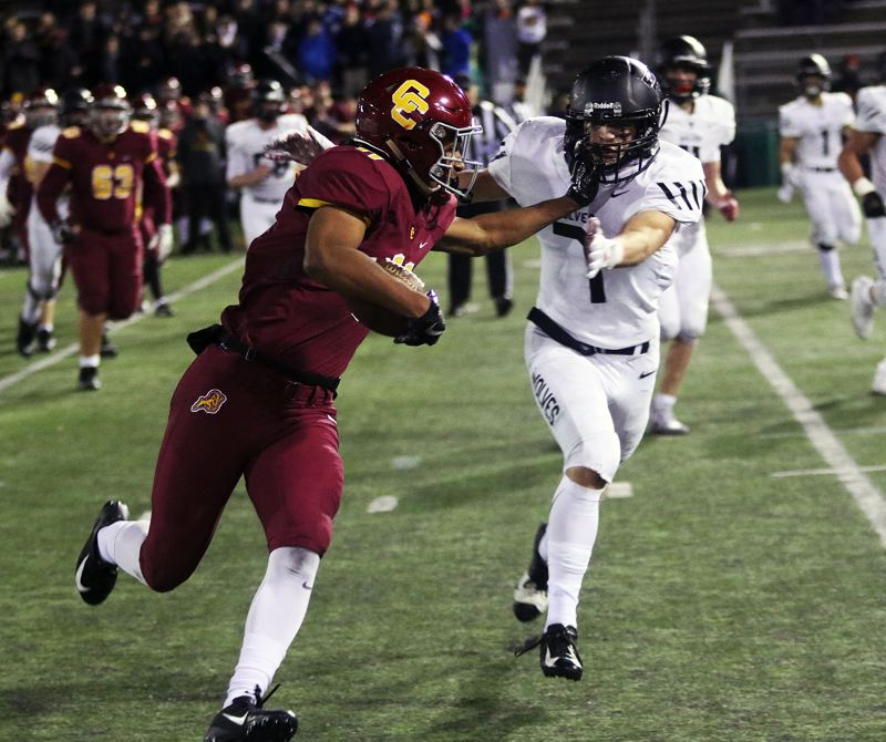 TIMES PHOTO: DAN BROOD - Central Catholic junior receiver Silas Starr (left) tries to get past Tualatin junior Luke Marion.
