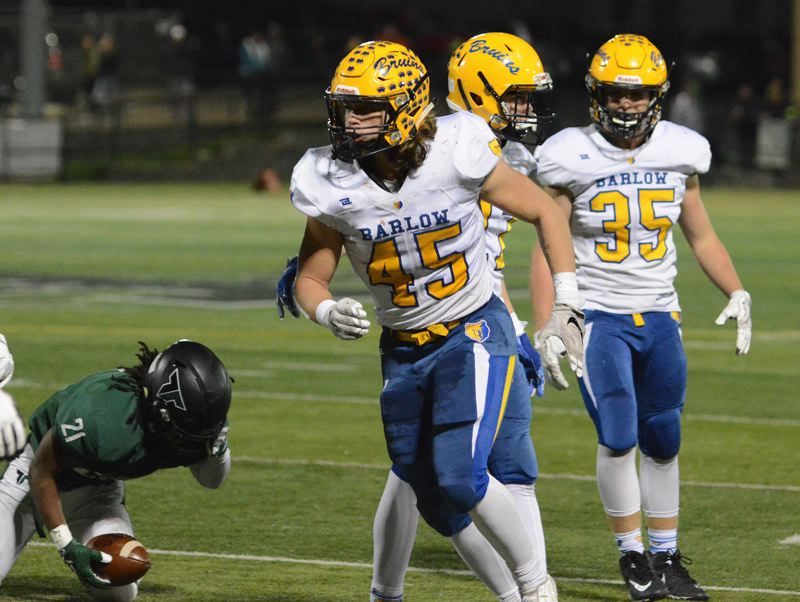 OUTLOOK PHOTO: DAVID BALL - Barlow linebacker Jared Eggleston celebrates after dropping Tigard running back Malcolm Stockdale in the backfield during the third quarter.