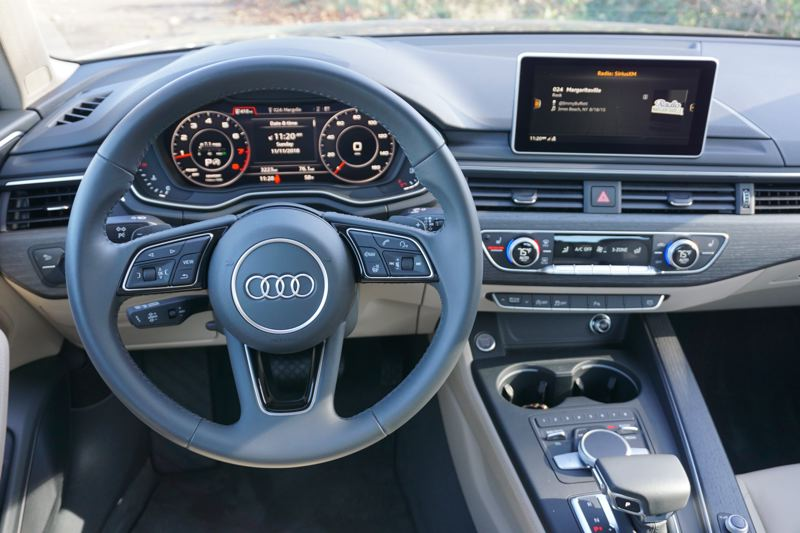 PORTLAND TRIBUNE: JEFF ZURSCHMEIDE - In the cabin, Audi has given the A4 a state-of-the-art driver information and control system.