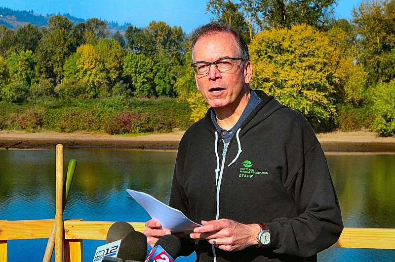 DAVID F. ASHTON - Portland City Commissioner Nick Fish unofficially welcomed juvenile salmon into the Oaks Bottom Wildlife Refuge through the newly constructed waterway - at the Oaks Bottom reopening ceremony.