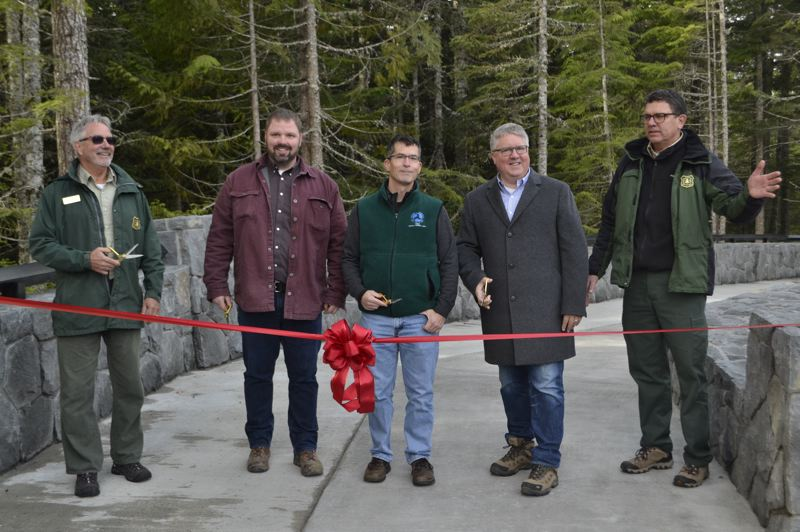 POST PHOTO: BRITTANY ALLEN - USFS and WFLHD officials cut the ribbon to open the new Mirror Lake Trailhead.