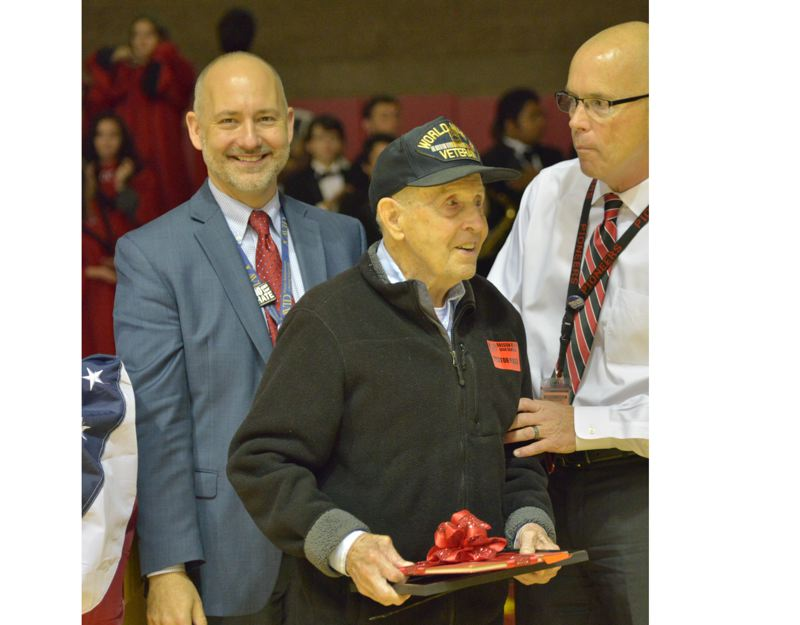 PHOTO BY: COBY EDWARDS - Orergon City High School alumnus and WWII vet Maurice Nichols is awarded OCHS Principals Award from Tom Lovell, right, as Superintendent Larry Didway (left) looks on.