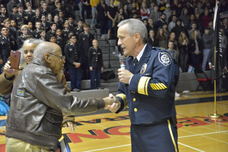PHOTO BY: COBY EDWARDS - Molalla Police Chief Rod Lucich and Tuskegee Airman Alex Jefferson shake hands.