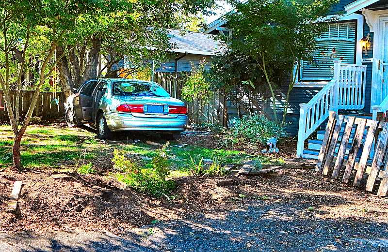 DAVID F. ASHTON - No one was at home at this Brentwood-Darlington house when the speeding getaway car smashed through the fence, drove through the yard, and was stopped hard by a sturdy tree.