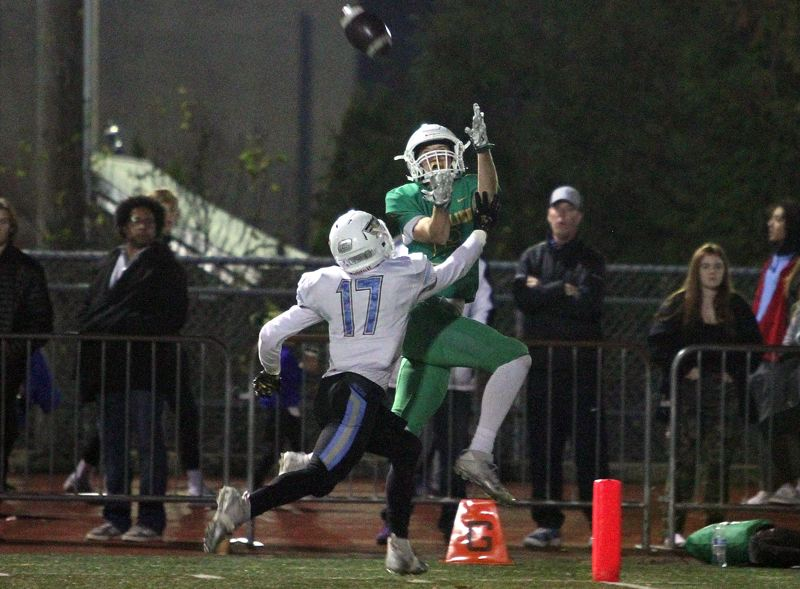TIDINGS PHOTO: MILES VANCE - West Linn senior wide receiver Jake Mastrandrea makes a touchdown catch in his team's 55-20 win over Lakeridge on Friday at West Linn High School.