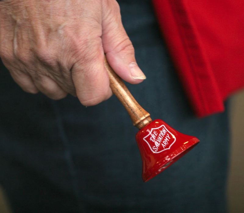 FILE PHOTO - The Salvation Army relies on a mix of paid seasonal workers and volunteers to ring their iconic red bells and collect donations outside stores during the holiday season.