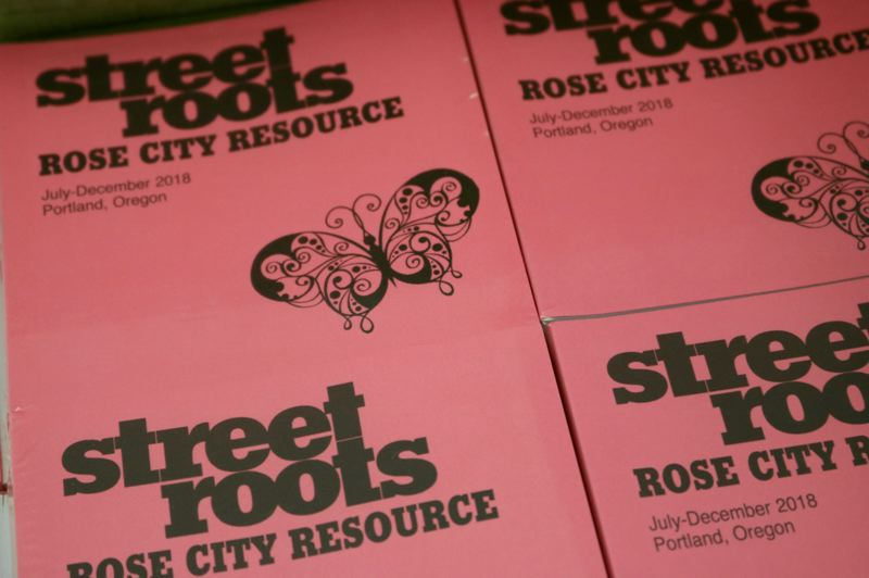 TRIBUNE PHOTO: ZANE SPARLING - Copies of the Street Roots resource guide were distributed to homeless people in Portland on Monday, Nov. 14 by volunteers with Impact NW.