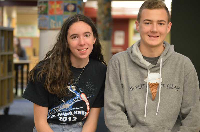 SPOKESMAN PHOTO: CLARA HOWELL  - Eighth-graders Fallon Leishman, left, and Carson Puppo say less memberships will allow Junior Scoopers to have a more personal relationship with customers.