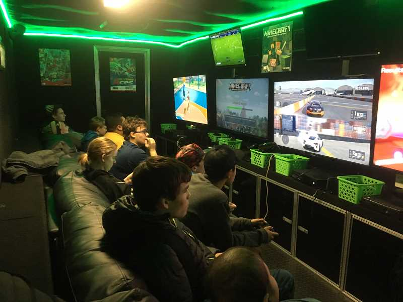 SPOKESMAN PHOTO: CLARA HOWELL - WHS students students crowded in the GameTruck to play Mario Kart and other video games during WHS's Unified Game Night.