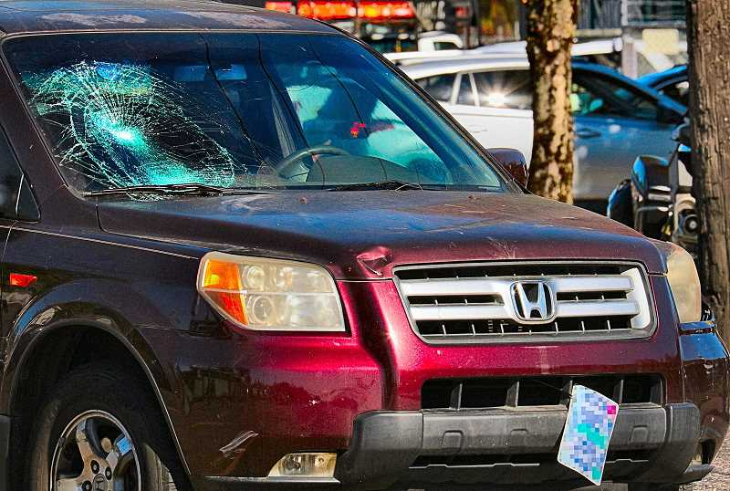 DAVID F. ASHTON - Dents in the front of the Honda, and the cracked windshield show the impact of the collision.