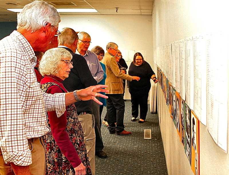 DAVID F. ASHTON - Members and guests examine membership rolls and other exhibits as the Reedwood Friends Church celebrated its 125th anniversary on November 4th.