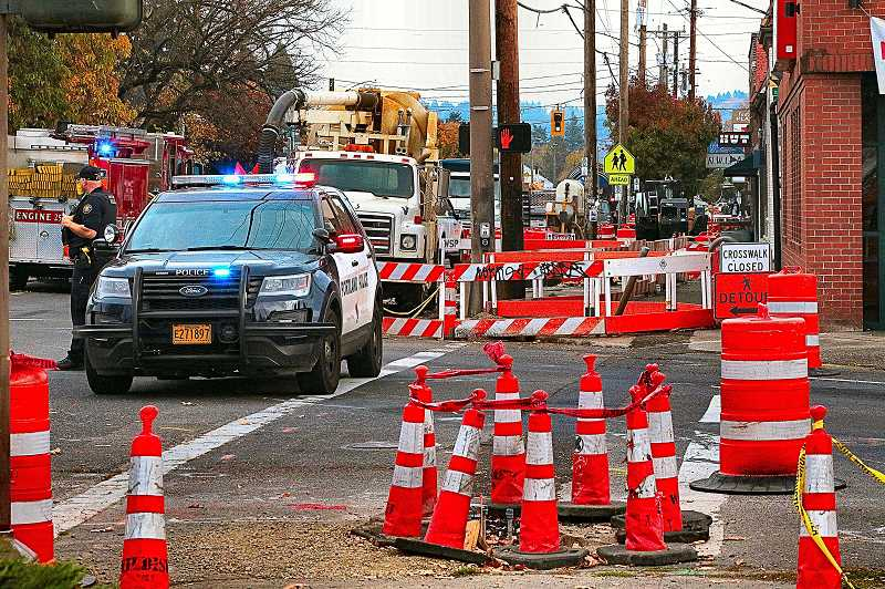 DAVID F. ASHTON - S.E. Foster Road was closed to traffic for hours for the repair, when a horizontal directional drilling rig bit chewed through a buried plastic natural gas service line.