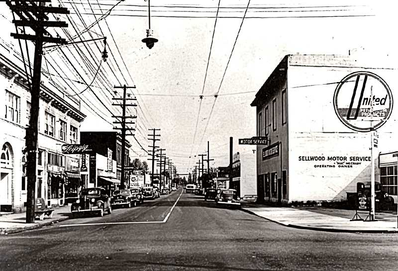 COURTESY OF SMILE HISTORY COMMITTEE - A 1940s snapshot of the 13th Avenue and Tacoma Street intersection, looking north - showing how Sellwood looked then. Sellwood Motor Service is on the right, and the Leipzig Café in its second location is on the left. The electric bus (in the distance, powered by overhead wires) had replaced the streetcar that once ran north on 13th to Westmoreland.