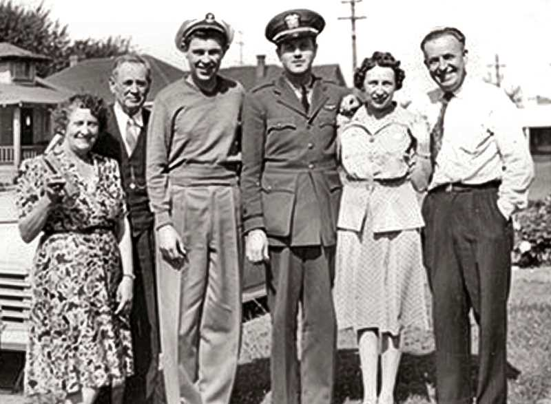 PHOTO COURTESY OF SCOTT GRIFFITH - A family photo from 1944. Every familys dream was for their son or daughter to return safely from the war front. Bill Griffith, in the military uniform, was a Lieutenant Junior Grade - a pilot in the Navy. His parents, Mary and Esta Griffith, are on the right; and his grandparents Eva and Bill Newton are on the left. Bills brother Gary is wearing Bills officer cap. The Griffith family ran the ByBee Grocery for over forty years.
