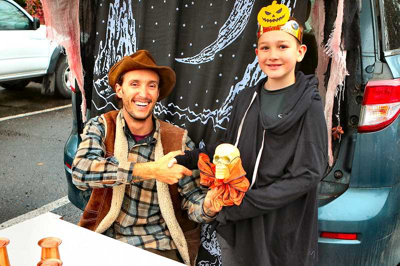 DAVID F. ASHTON - John Matychs old west gambling parlor won the Trunk-or-Treat Theme award, presented by Stryker Reed - who was about to enjoy his birthday party, which was also being held at the Community Center at the same time.