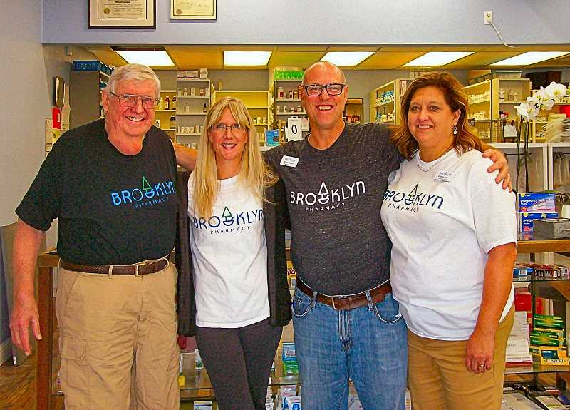 RITA A. LEONARD - From left is Mike Dardis, former owner of Brooklyn Pharmacy, and his daughter, Kelly McAlbin who still works there; and new owners Pat and Kim Hubbell. All are attired in the stores new emblematic T-shirts - which are for sale!