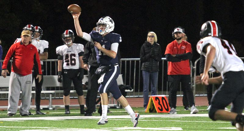 REVIEW FILE PHOTO - Lake Oswego senior quarterback Jackson Laurent (shown here against North Medford) completed 13 of 17 passes for 229 yards and three touchdowns in his team's 49-14 home win over Oregon City in Friday's second round of the Class 6A state playoffs.