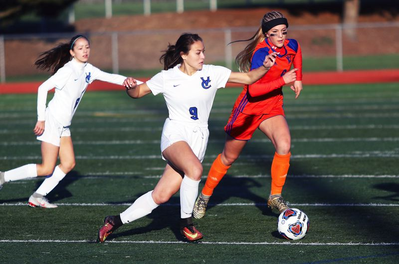 TIMES PHOTO: DAN BROOD - Valley Catholic senior Callie Kawaguchi (9) chases after the ball during Saturday's Class 4A state championship match.