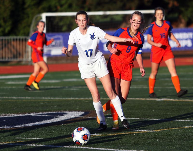TIMES PHOTO: DAN BROOD - Valley Catholic senior Josephine Clark (17) goes after the ball ahead of Hidden Valley senior eagan Danner during Saturday's title match.