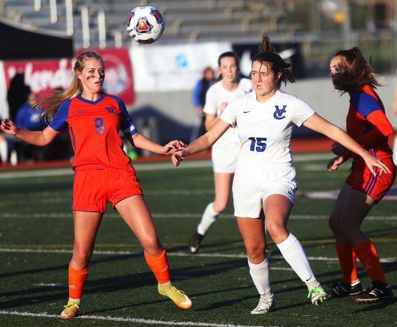 TIMES PHOTO: DAN BROOD - Valley Catholic senior Chloe Brock (15) and Hidden Valley senior Teagan Danner both eye the ball during Saturday's state championship match.